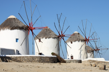 Windmills on a hillside near the sea in Mykonos Island, Greece