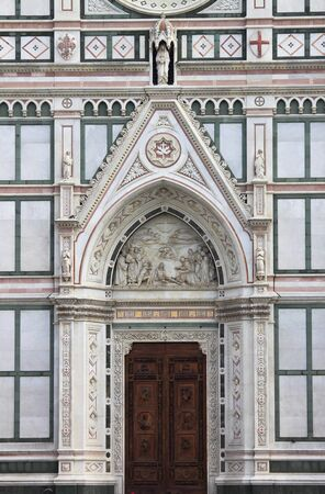 ornamented: Portal of the Holy Cross Basilica in Florence, Italy Stock Photo