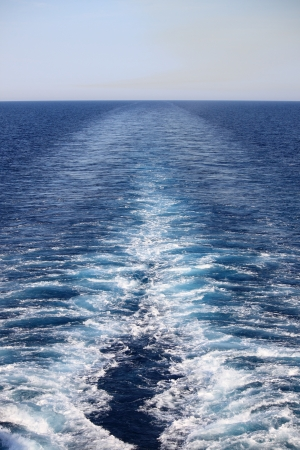 leave: Wake of a cruise ship on the open ocean