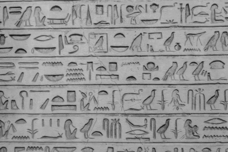Old egyptians hieroglyphs carved on the stone photo