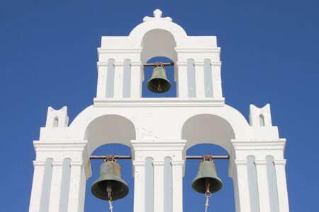 Orthodox bell tower in Santorini Island, Greece photo