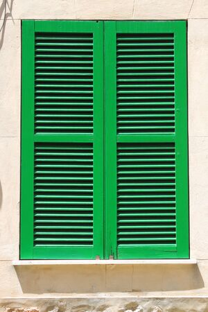 Italian style shutters in a old palace photo