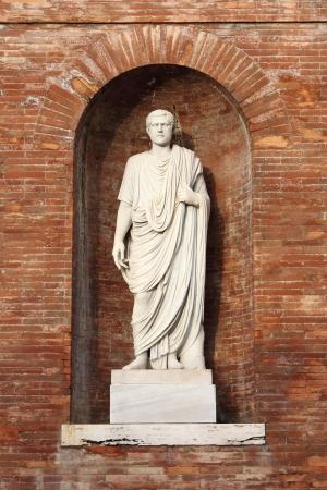 senator: Statue of a roman Senator located in Quirinale Square. Rome, Italy