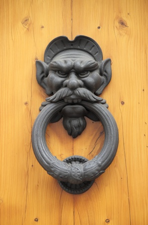 Bronze lion head knocker on a wooden door Stock Photo - 15301238