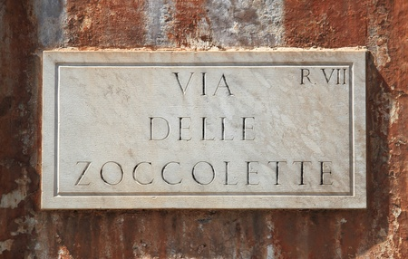 Old street sign at Zoccolette Street in Rome, Italy