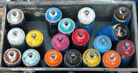 Box with color spray cans used by an artist photo