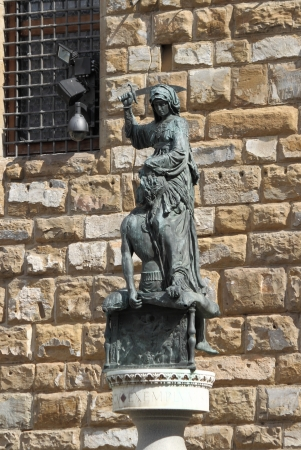 beheading: Statue of Judith and Holofernes in Signoria Square of Florence. Italy