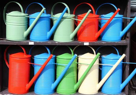 resell: Rows of colorful watering cans Stock Photo