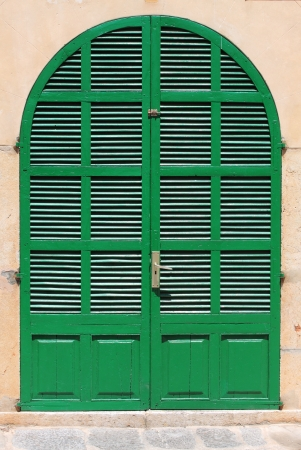 Florence, Italy - May 24, 2012: Italian style house entrance with shutters Stock Photo - 15740710