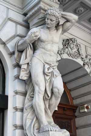 marble palace: Brawny statue supporting a column on a renaissance palace. Metaphor of power Stock Photo