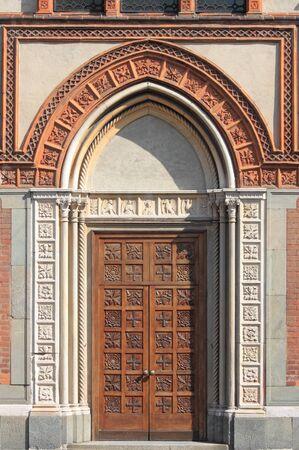 Entrance door of the romanic style church of Santa Maria in Strada. Monza, Italy photo