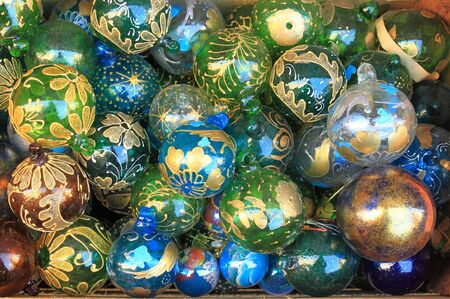 opalescent: Pile of glass christmas baubles