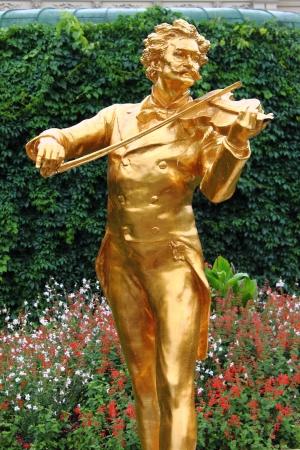 Statue of Johann Strauss in Vienna, Austria photo