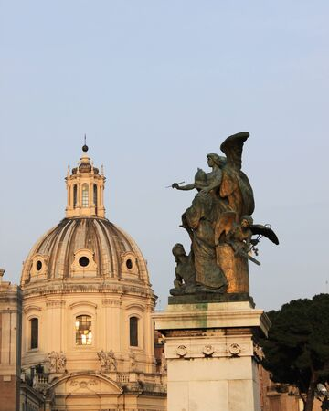 Church dome and an angel in Rome, Italy photo
