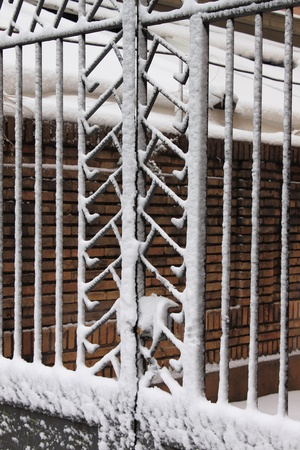 wintriness: Iron gate covered by snow in wintertime Stock Photo