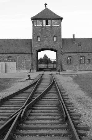 tortured: Oswiecim, Poland - July 23, 2011: Main entrance to Auschwitz Birkenau Concentration Camp Editorial