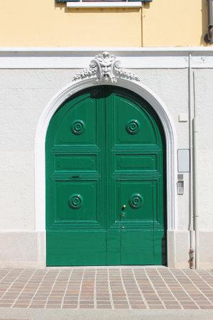 friezes: Monza, Italy - September 15, 2012: Renaissance style front door painted of green