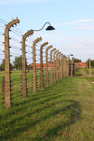 Oswiecim, Poland - July 23, 2011: Barbed wire electrical fence at Auschwitz Birkenau Stock Photo - 16462952