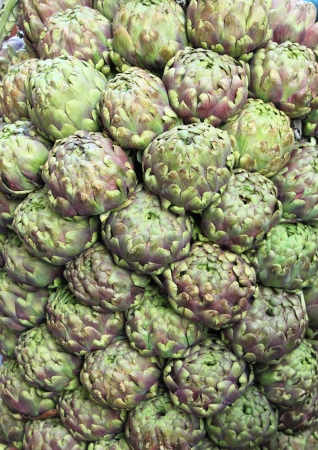 greengrocery: Composition of fresh artichokes in a greengrocery Stock Photo
