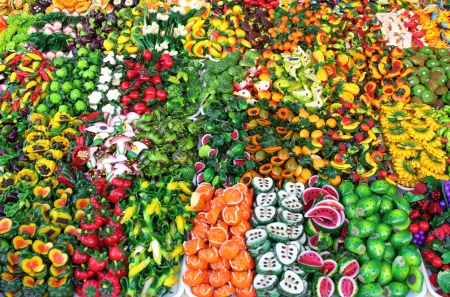 Pile of fridge magnets for sale in a market stall Stock Photo - 16573504
