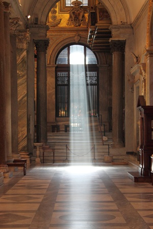 Rome, Italy - May 9 2010: Mystic light in the nave of a Santa Maria in Trastevere church