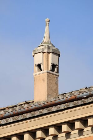 Artistic rooftop chimney on a renaissance style house photo