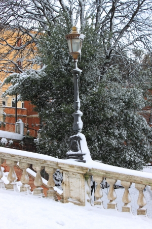 Renaissance street light in wintertime under snow photo