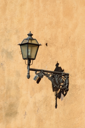 Old medieval street lamp photo