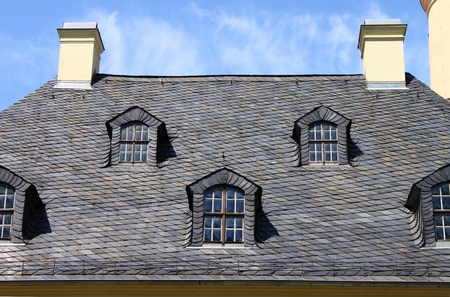 Mansard windows in a old style roof photo