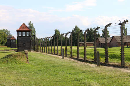 Oswiecim, Poland - July 23, 2011: Barbed wire electrical fence at Auschwitz Birkenau concentration camp Stock Photo - 16817389
