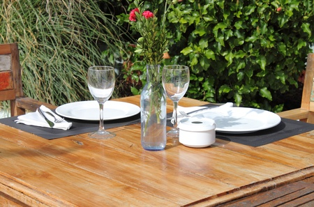 Table setting in a garden with flowers photo