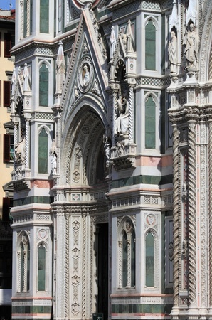 Lateral portal of Florence cathedral. Italy photo