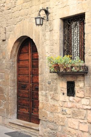 lamp window: Medieval door with lamp, window and flower pots