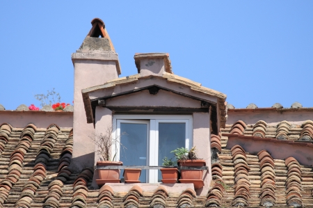 Mansard window in a old style roof photo