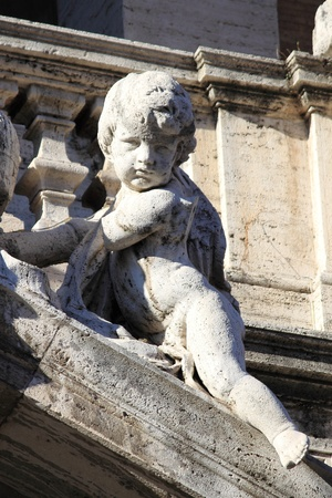 Angel statue on the facade of Saint Mary Major Basilica in Rome, Italy photo