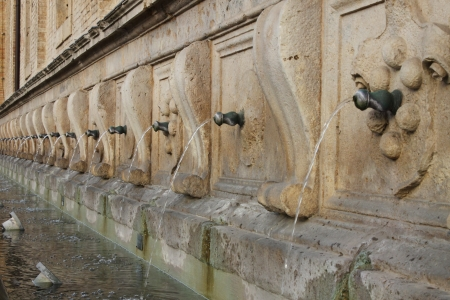spitting: Medicean Fountains in Saint Mary of Angels Cathedral. Assisi, Italy Stock Photo