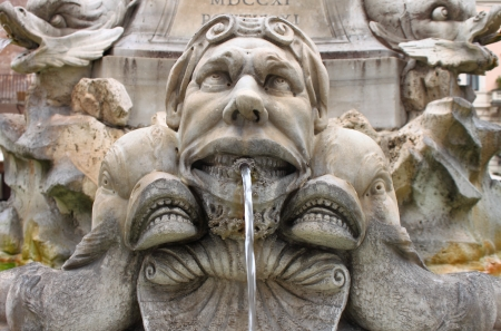spitting: Marble fountain in Pantheon square in Rome, Italy Stock Photo