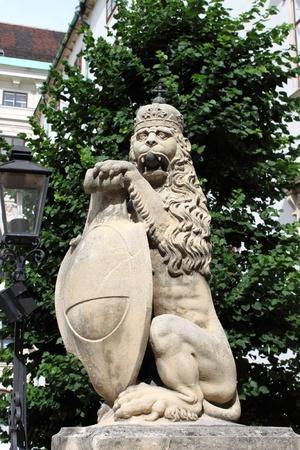 hofburg: Lion statue with shield in Vienna Hofburg, Austria Stock Photo