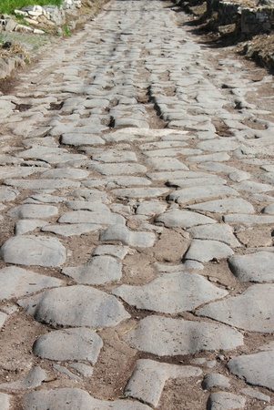 Cobblestone pavement in the Appian way of Rome, Italy