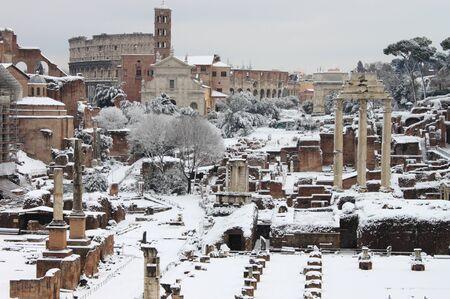 The Roman Forum under snow in Rome, Italy photo