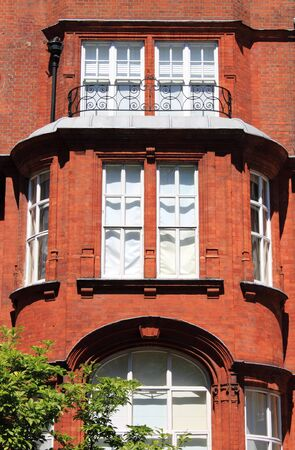 London UK - May 22, 2010: Covered balcony in a british red brick mansion