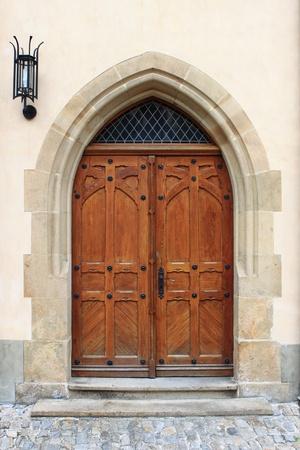 Medieval front door in Prague, Czech Republic photo