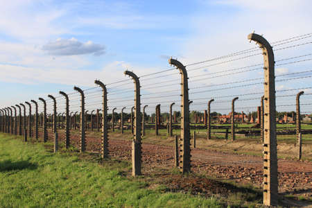 Barbed wire electrical fence at Auschwitz Birkenau concentration camp, Poland photo