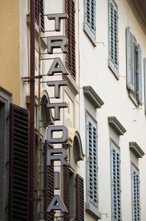 Trattoria vintage sign on an old building in Florence, Italy . photo