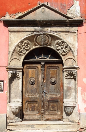 Cesky Krumlov, Czech Republic - July 19, 2011: Medieval front door with decorations