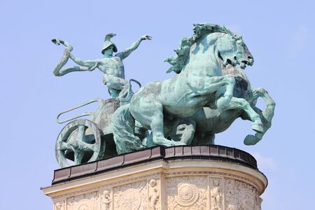 Allegorical statue of War in Heroes Square of Budapest, Hungary photo