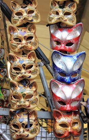 Rows of venetian carnival masks photo