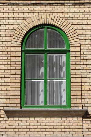 Detalle de una ventana de arco en un edificio de ladrillo rojo Foto de archivo - 17948474