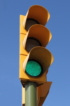 manage transportation: Traffic light with green light on