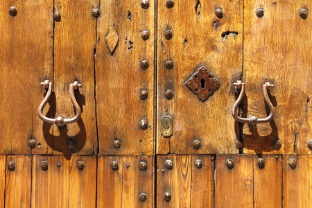 Closeup of an ancient wood front door of a castle photo
